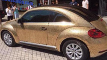 Volkswagen Beetle covered with more than 10,000 coins