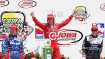 Victory lane- race winner Dan Wheldon, second place Hideki Mutoh, third place Marco Andretti