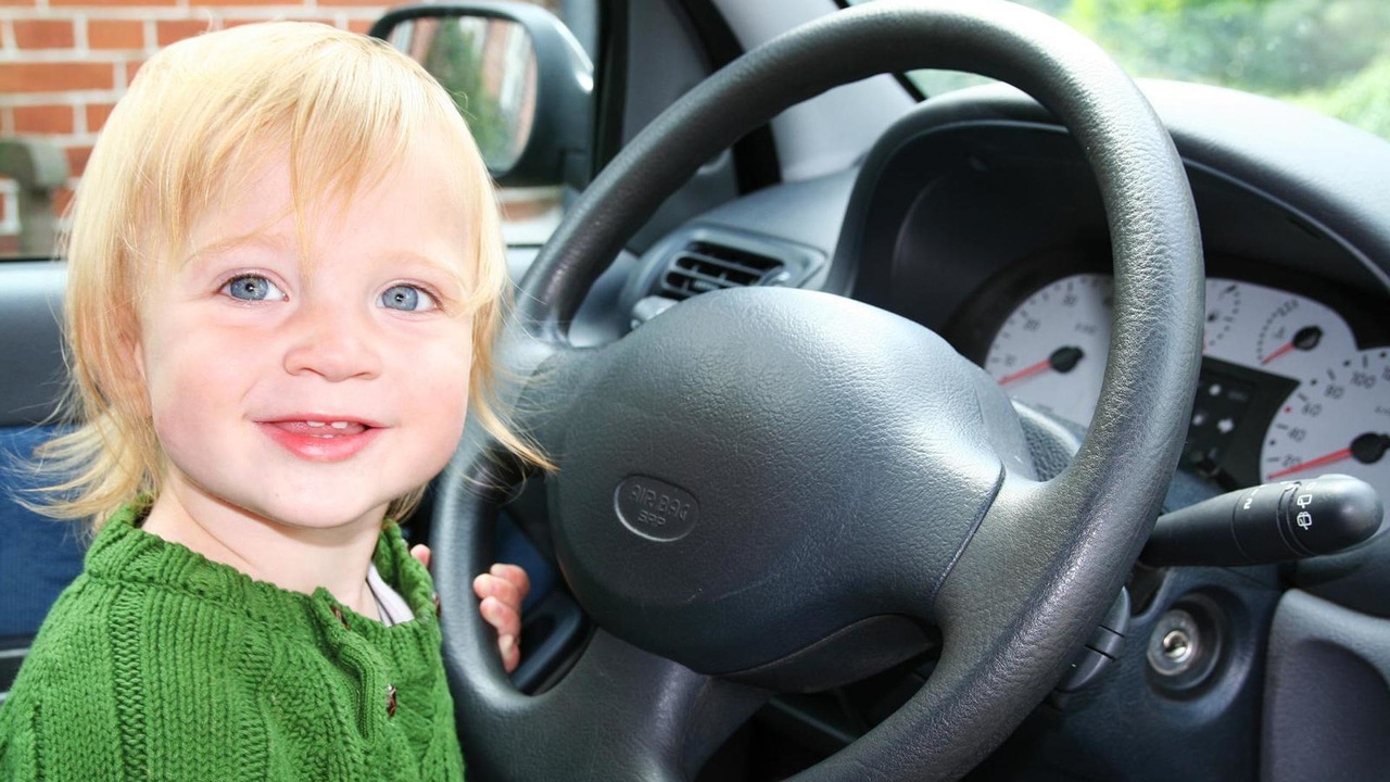 Child behind the steering wheel