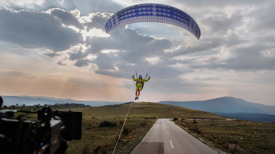 Volvo Trucks performs big stunt with paraglider and a bridge