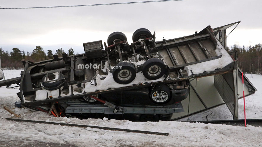 Two Porsche 911s land upside down after transporter tips in wind