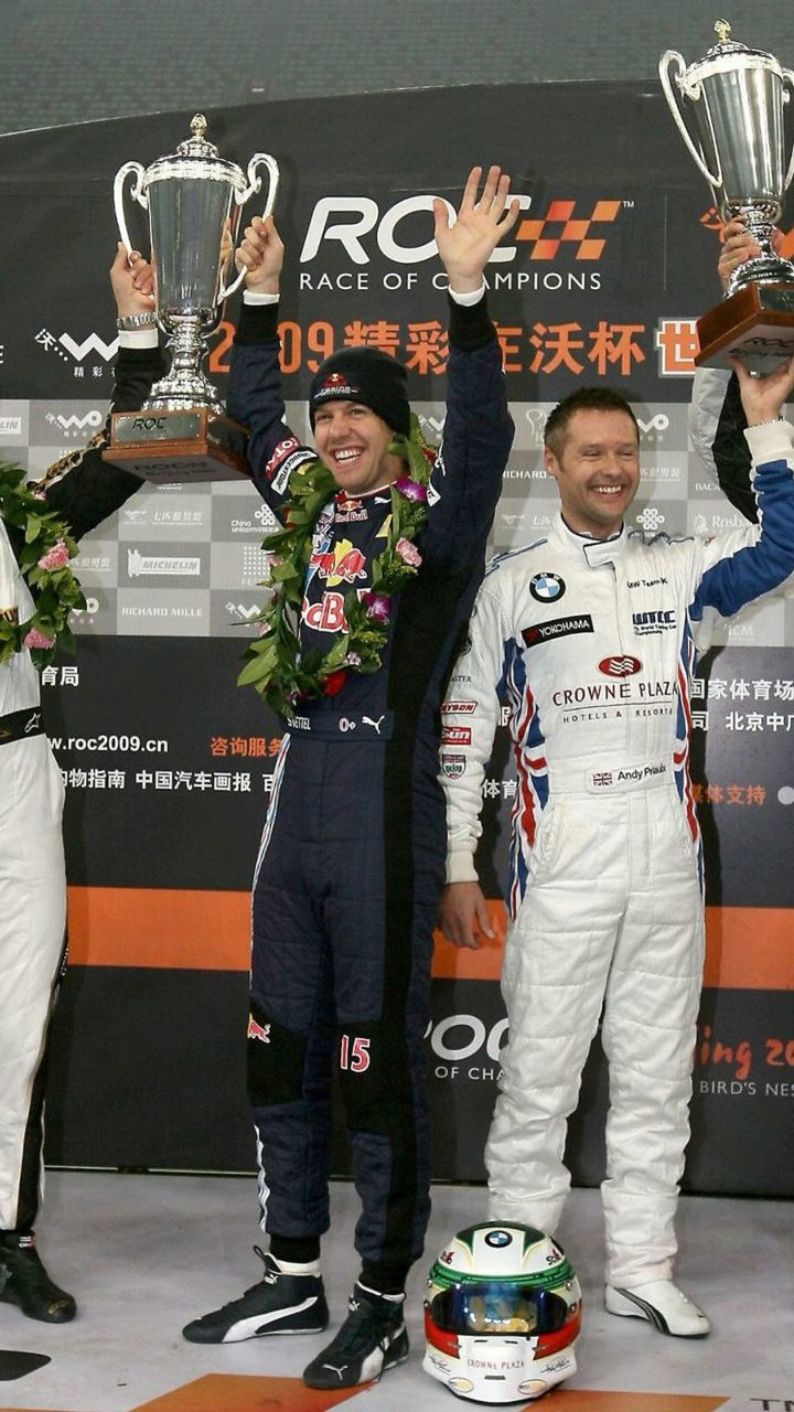 Winners Sebastian Vettel and Michael Schumacher of Team Germany celebrate on the podium with Jenson Button and Andy Priaulx of Team GB.