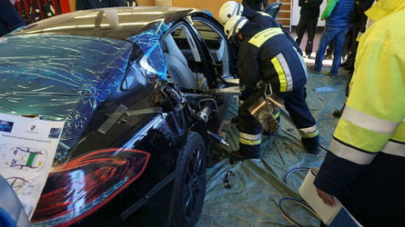 Firefighters cut apart a brand new Porsche Panamera