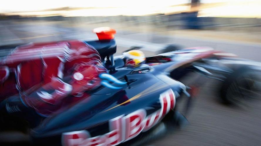Toro Rosso working on blown exhaust - Buemi