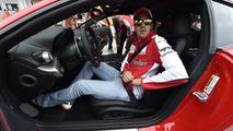 Sebastian Vettel with the Ferrari F12berlinetta