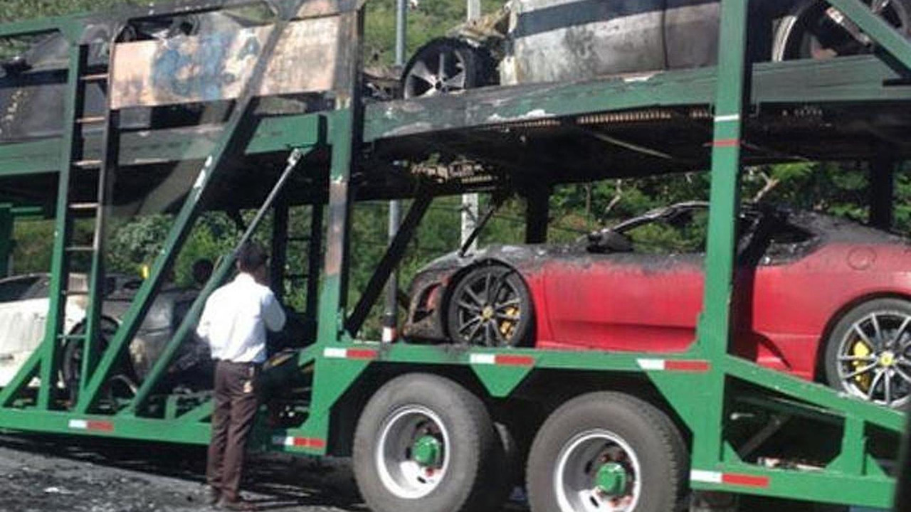 Trailer packed with supercars burns in Thailand 30.05.2013