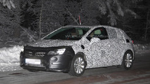 Next-gen Opel Astra spied in the night showing LED headlights and taillights