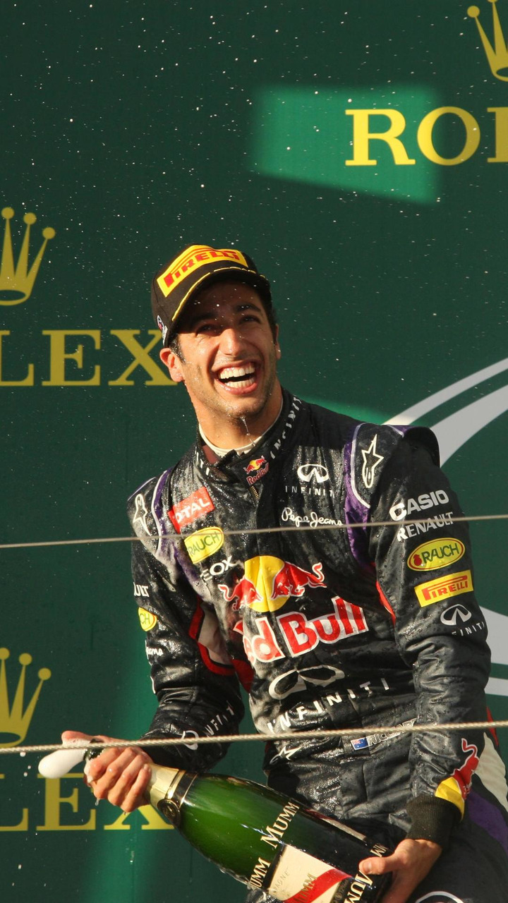 Daniel Ricciardo (AUS), celebrates his second position with the champagne on the podium, 16.03.2014, Australian Grand Prix, Albert Park, Melbourne / XPB