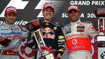 Jarno Trulli (ITA) 2nd, Toyota F1 Team , Sebastian Vettel (GER) 1st, Red Bull Racing and Lewis Hamilton (GBR) 3rd, McLaren Mercedes - Formula 1 World Championship, Japanese Grand Prix, Sunday Podium, Suzuka, Japan, 04.10.2009