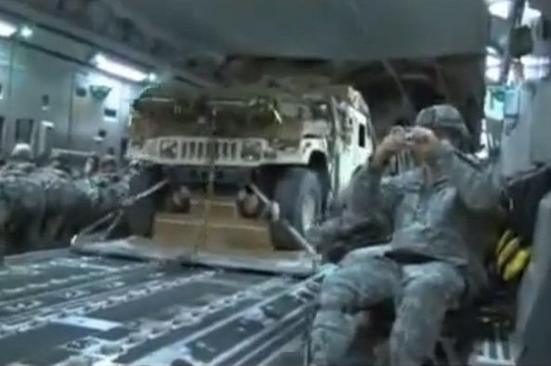 Watch Four Humvees, 50 Paratroopers Drop out of a Military Cargo Plane