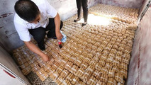 Chinese man buys a luxury car with coins