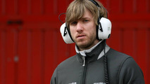 Heidfeld would rather watch than race at back