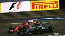 Nico Rosberg, Mercedes AMG F1 W06 and Kimi Raikkonen, Ferrari SF15-T battle for position