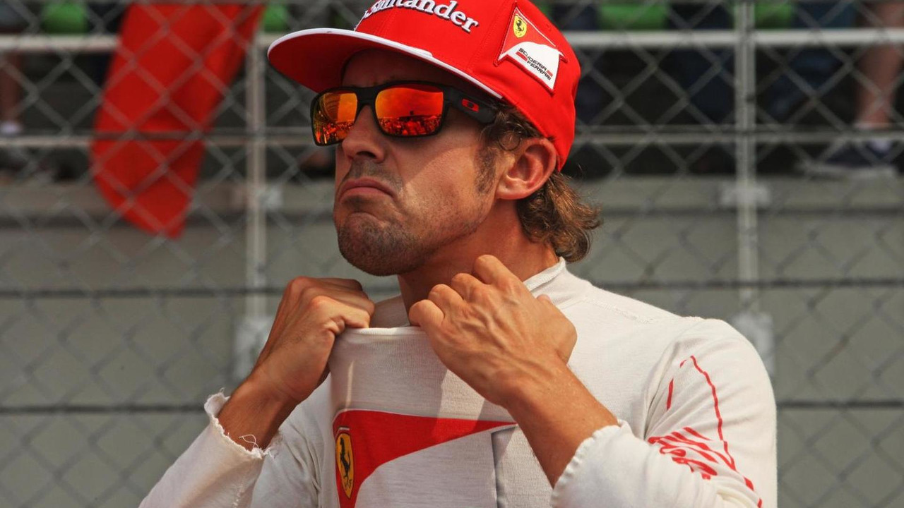 Fernando Alonso (ESP) Ferrari on the grid. 30.03.2014. Formula 1 World Championship, Rd 2, Malaysian Grand Prix, Sepang, Malaysia
