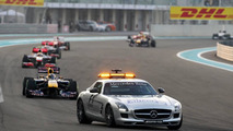 The safety car leads Sebastian Vettel (GER), Red Bull Racing, RB6 - Formula 1 World Championship, Rd 19, Abu Dhabi Grand Prix, 14.11.2010