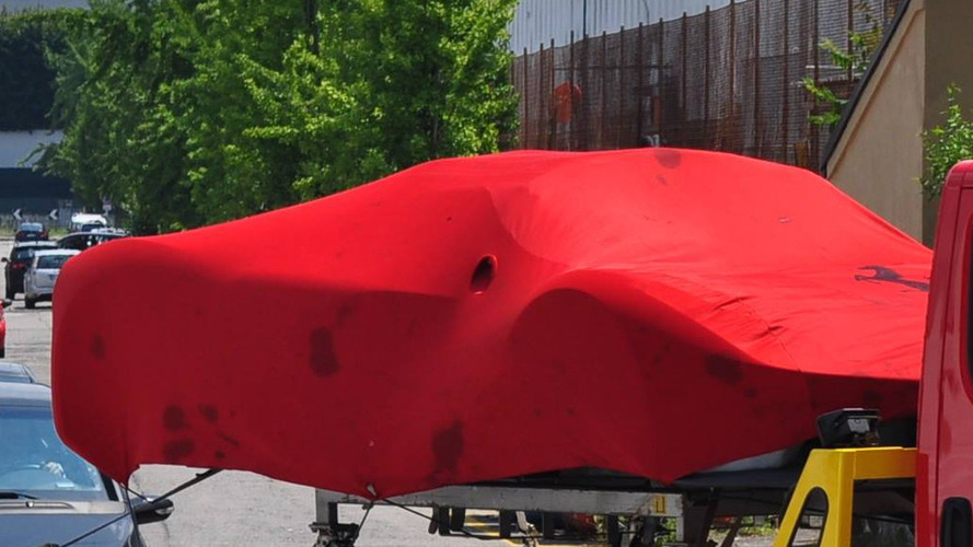 Is that a LaFerrari Spider under the cover?