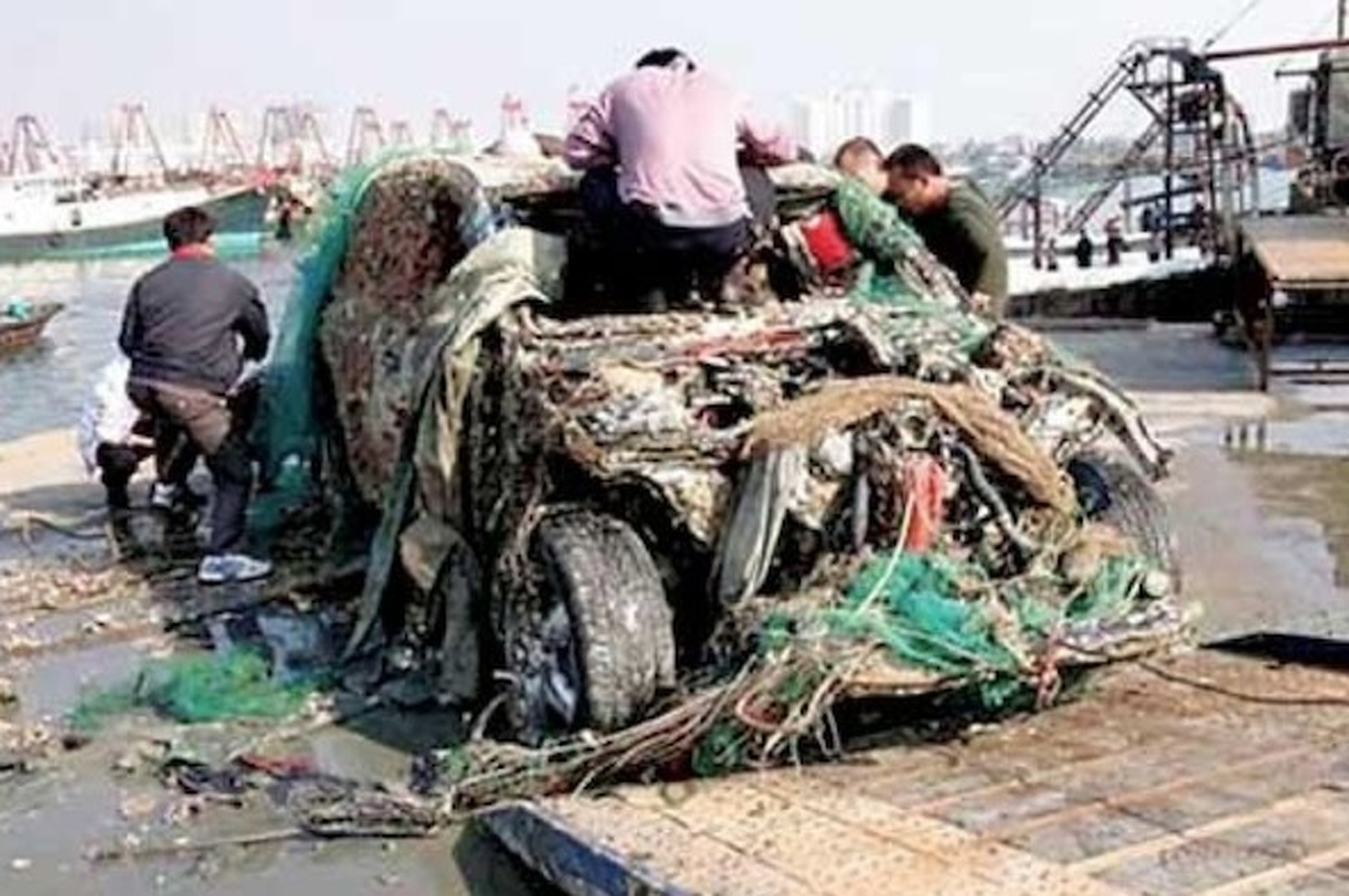 Chinese Fisherman Reel Up Dead Porsche Cayenne
