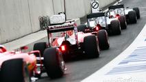 Nico Rosberg, Mercedes AMG F1 W06; Lewis Hamilton, Mercedes AMG F1 W06; Sebastian Vettel, Ferrari SF15-T; and Kimi Raikkonen, Ferrari SF15-T at the end of the pit lane