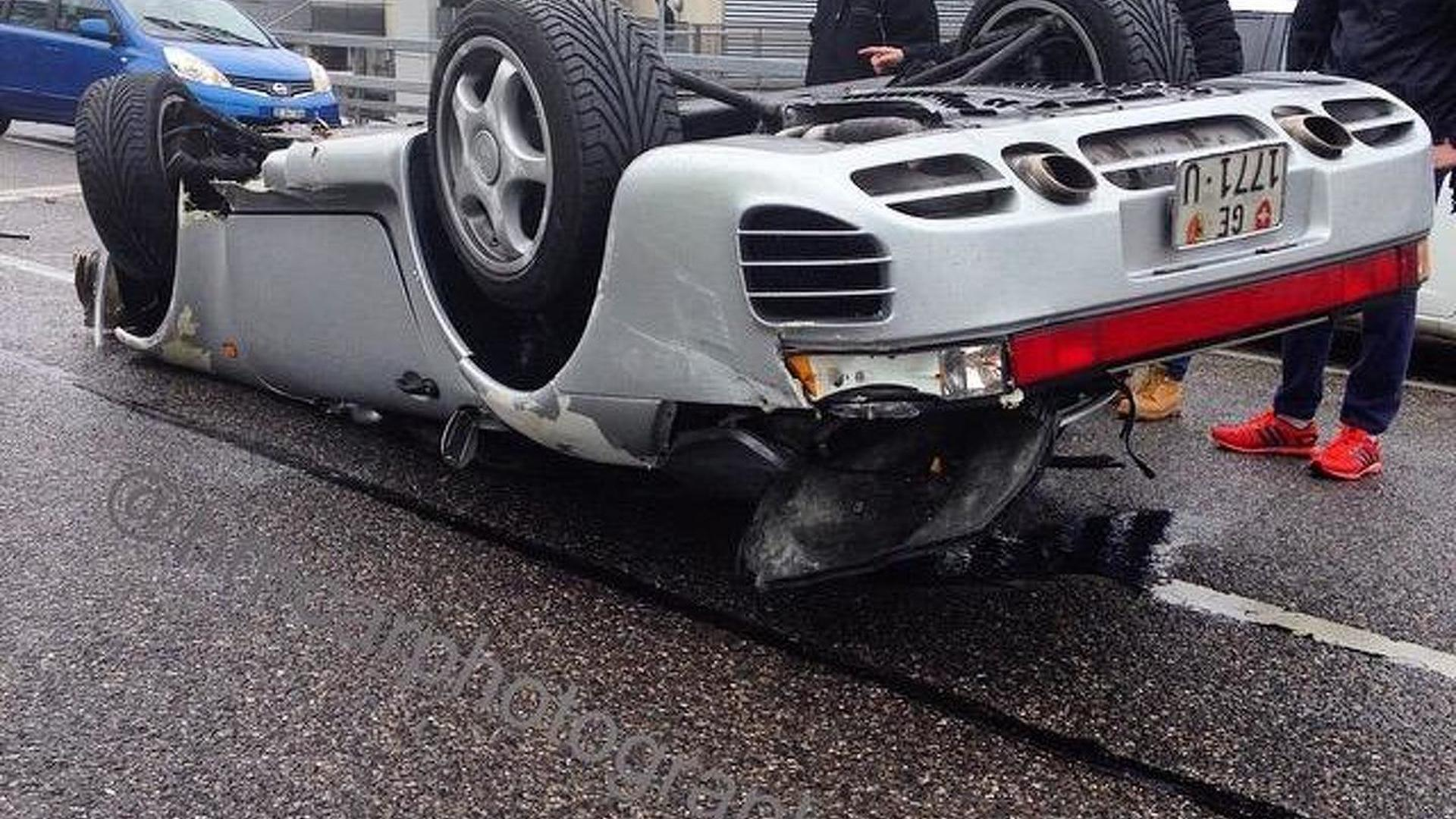 Porsche 959 flips over in Geneva after speeding on wet road