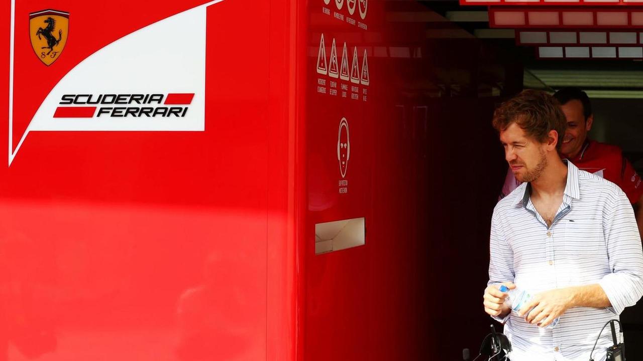 Sebastian Vettel (GER) leaves the Ferrari garage / XPB