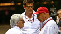 (L to R)- Bernie Ecclestone, with Toto Wolff, Mercedes AMG F1 Shareholder and Executive Director and Niki Lauda Mercedes Non-Executive Chairman