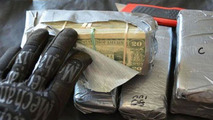 Man finds seven bundles of cash hidden in his recently purchased used car