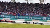 Lewis Hamilton, Mercedes AMG F1 W07 Hybrid leads at the start of the race as Nico Rosberg, Mercedes AMG F1 W07 Hybrid and Sebastian Vettel, Ferrari SF16-H collide