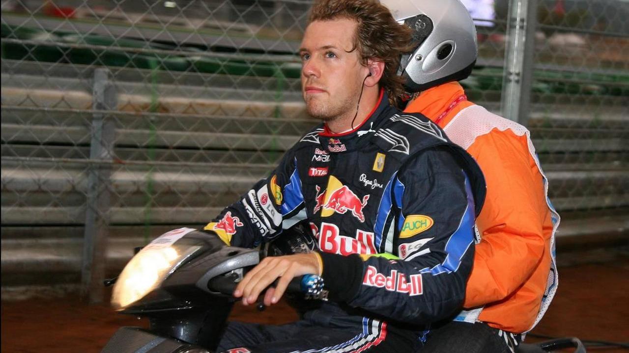Sebastian Vettel (GER), Red Bull Racing rides back to the pits after his engine blew - Formula 1 World Championship, Rd 17, Korean Grand Prix, 24.10.2010 Yeongam, Korea