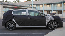 Kia Forte sedan, hatchback and coupe facelift spied up close