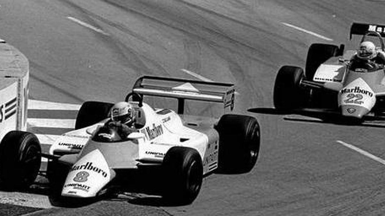 Niki Lauda of Austria, driving car No.8 for Team McLaren, passes Alfa Romeo driver Bruno Giacomelli of Italy in car No.22 during early lap of the Long Beach Grand Prix April 4, 1982 / AP Photo/Reed Saxon