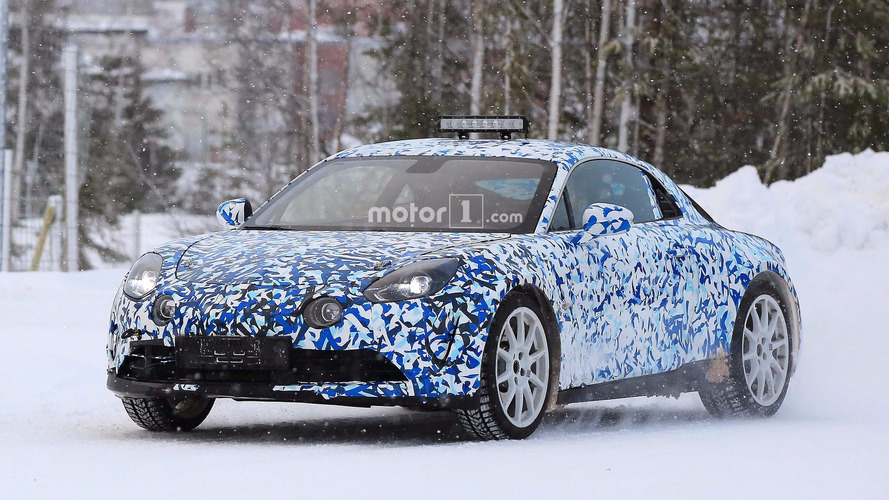 Alpine sports car spied kicking up snow during testing