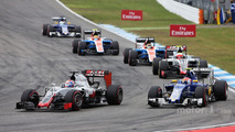 Romain Grosjean, Haas F1 Team VF-16 and Felipe Nasr, Sauber C35 battle for position