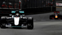 Lewis Hamilton, Mercedes AMG F1 W07 Hybrid on track ahead of Daniel Ricciardo, Red Bull Racing RB12