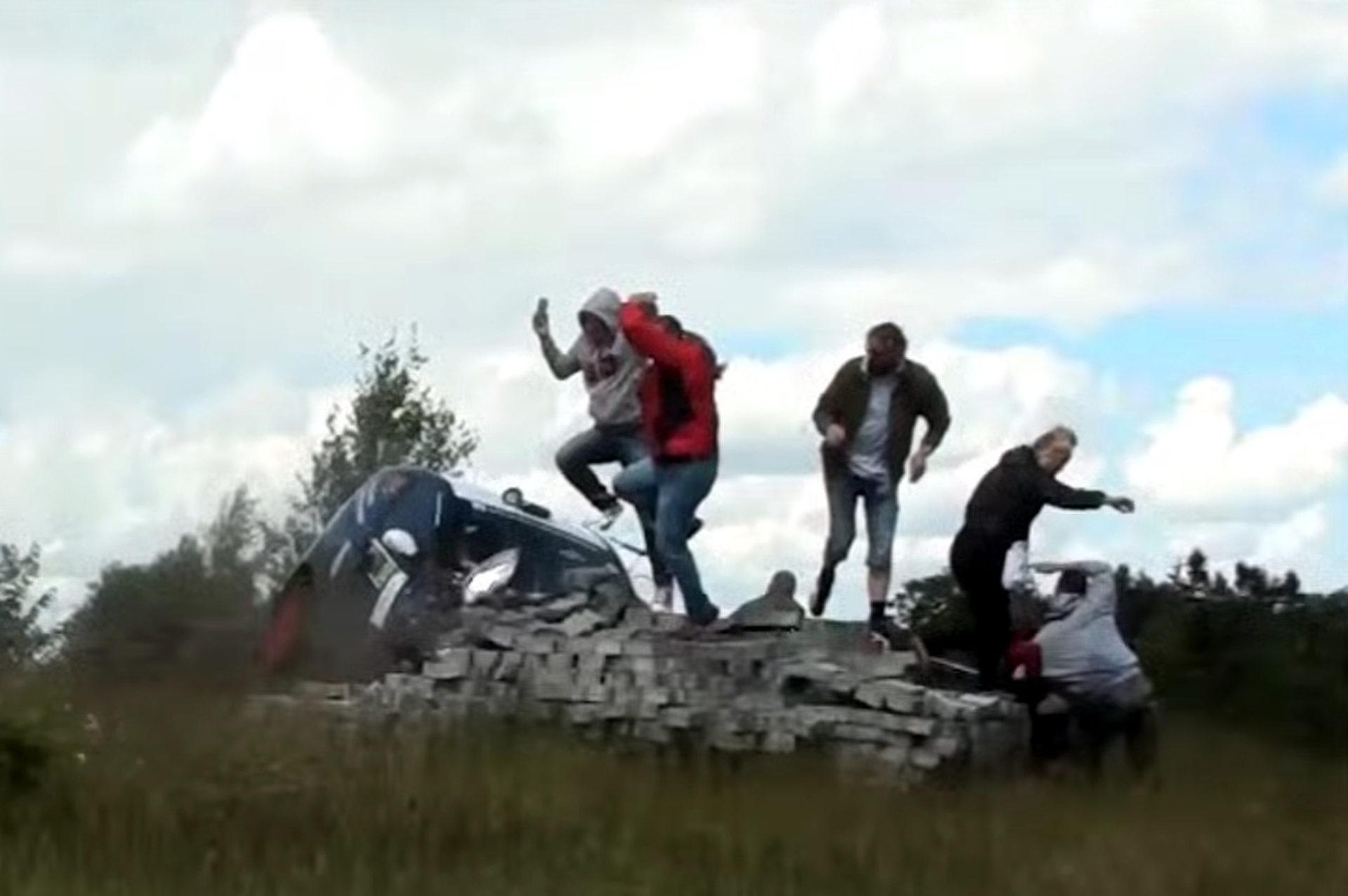 Rally Car Slides Off Course, Nearly Hits Crowd of Spectators [Video]
