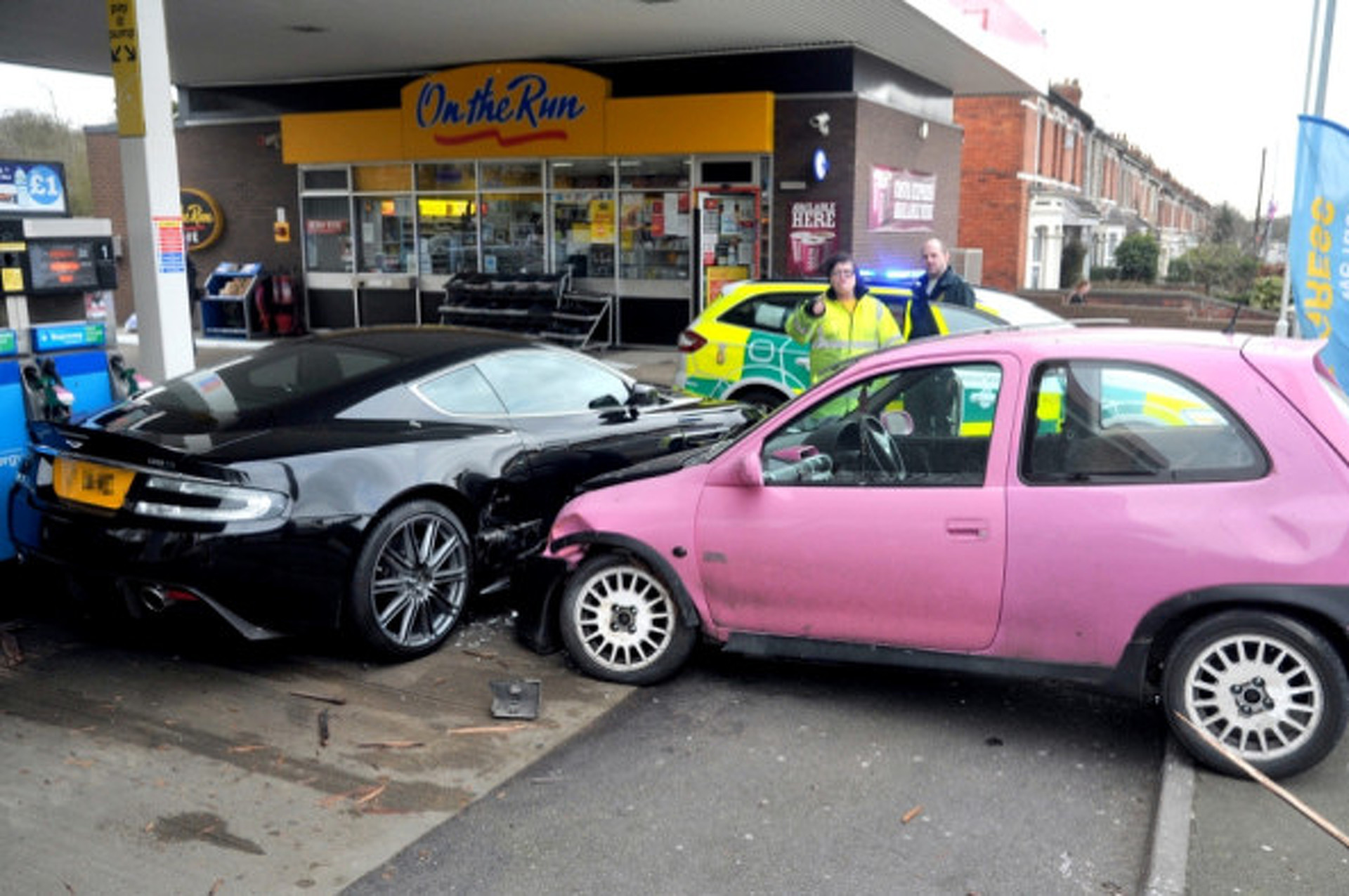 Pink Pound Hatchback Crashes Into Aston Martin In Uk