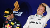 Race winner Nico Rosberg, Mercedes AMG F1 (Right) celebrates on the podium with second placed Daniel Ricciardo, Red Bull Racing