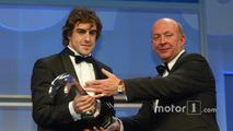 Fernando Alonso is handed the Gregor Grant Award by Nigel Roebuck