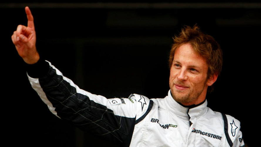 Button takes pole at the death in Spain
