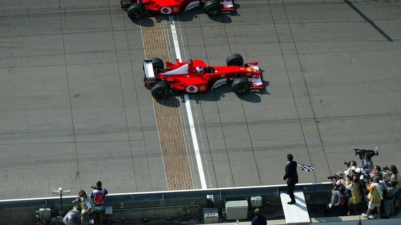 Michael Schumacher, Rubens Barrichello cross finish line together, 2002 SAP United States Grand Prix, 29.09.2002 Indianapolis, USA