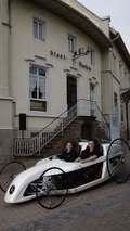 Trainees of the Daimler AG in the F-CELL Roadster in front of the town pharmacy in Wiesloch
