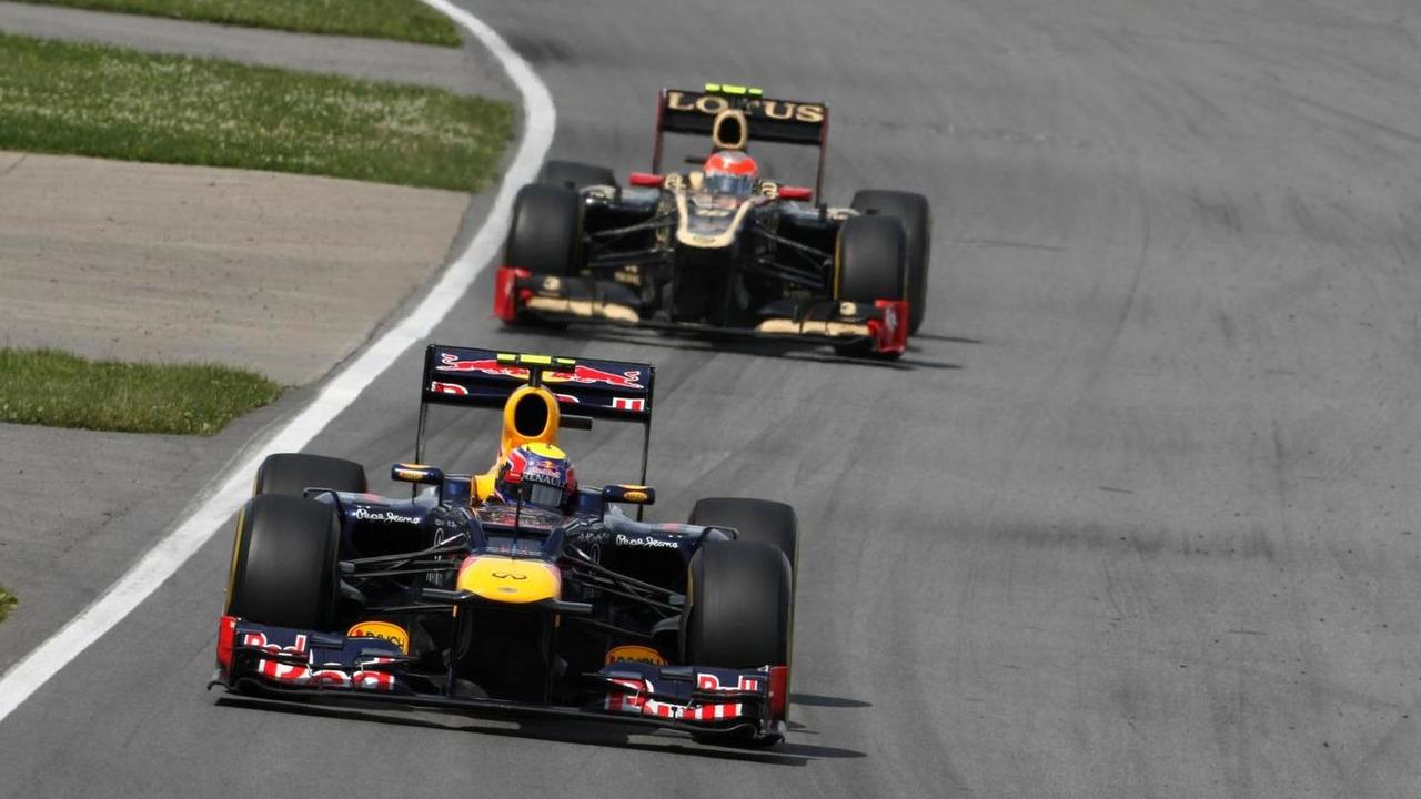 Mark Webber (AUS), Red Bull Racing and Romain Grosjean (FRA), Lotus F1 Team