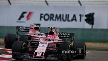 Esteban Ocon, Force India VJM10, leads Sergio Perez, Force India VJM10