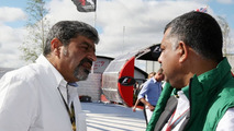 Vicky Chandhok (IND), father of Karun Chandhok (IND), Tony Fernandes, Lotus F1 Team, Team Principal - Formula 1 World Championship, Rd 10, British Grand Prix, 11.07.2010 Silverstone, England