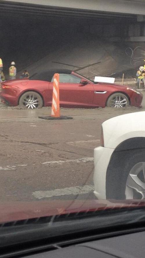 Jaguar F-Type driver ignores warnings, gets stuck in wet concrete