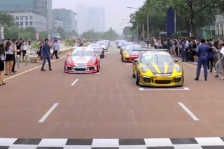 Watch a Porsche 911 Carrera Flash Mob on the Streets of Kuala Lumpur