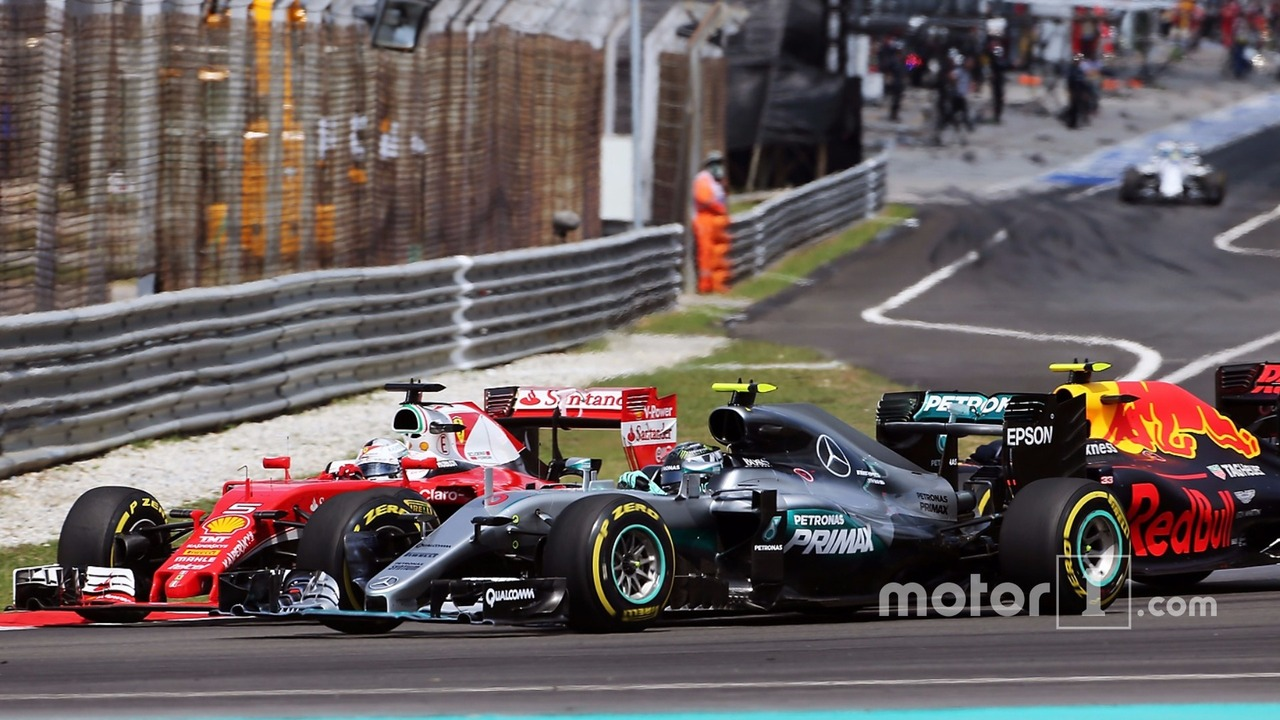 Sebastian Vettel, Ferrari SF16-H, Nico Rosberg, Mercedes AMG F1 W07 Hybrid, and Max Verstappen, Red Bull Racing RB12 collide at the start of the race