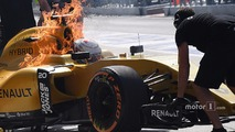 The burning car of Kevin Magnussen, Renault Sport F1 Team RS16