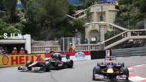 Mark Webber overtakes Bruno Senna during free practice for the 2010 Monaco Grand Prix