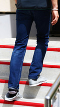 Nico Rosberg (GER) wearing his left shoe loosely after he cut a toe open on a beach / XPB