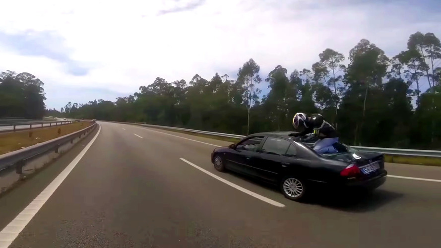 Lucky Rider Smashes Into Car, Lands On Back Shelf Safely